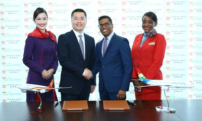 Photo Caption:  Manoj Papa, Chief Executive Officer of Air Seychelles, and Li Dianchun, Commercial Director of Hong Kong Airlines, sign a codeshare agreement between the two airlines.