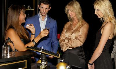 Sonia Irvine, Alexander Rossi and guest, being guided through Fragrance Du Bois' first concept boutique at the Fullerton Hotel, Singapore.