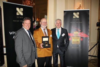 Fragrance Du Bois and Asia Plantation Capital Chief Executive Officer, Gary Crates, with the winner of the Price Prediction Game, Mr Khaled Diab and Asia Plantation Capital Geneva Channel Manager, Patrick Castagna.