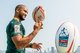 South African Sevens team poses with the gigantic rugby ball in Victoria Harbour