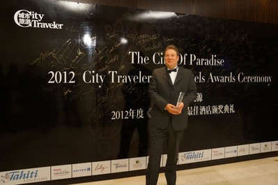 The picture shows that Mr. Paul Proctor, General Manager of the hotel, was presented the award