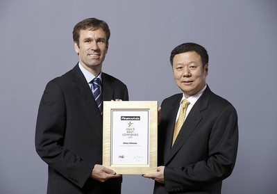 "Chairman Wang Xiaochu (Right) received ""Overall Best Managed Company in Asia"" award from FinanceAsia"